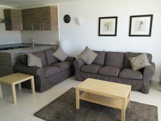Lounge with comfortable 2 and 3 seater sofas
