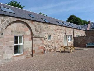 STEWARDS HOUSE, end-terrace cottage, woodburning stove, enclosed courtyard, in
