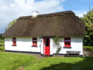 7 TIPPERARY THATCHED COTTAGE, quaint cottage with WiFi, fire, ground floor