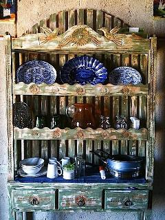 The dishware and equipment of the kitchen are part of mexican style of the house.