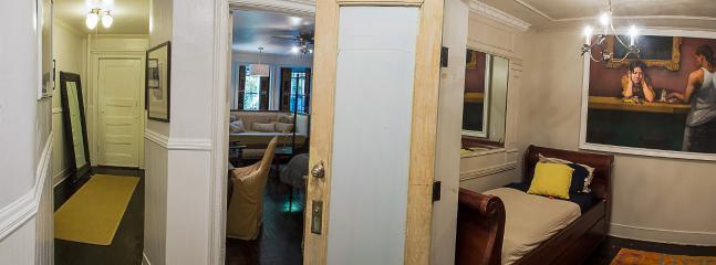 hallway with bedroom door open, looking to front entrance