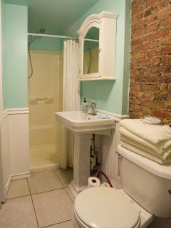 other side of bathroom with shower stall