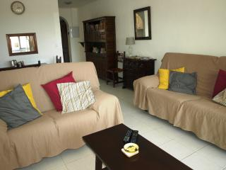 Lounge with dining area, cooling ceiling fan, TV, DVD & WiFi