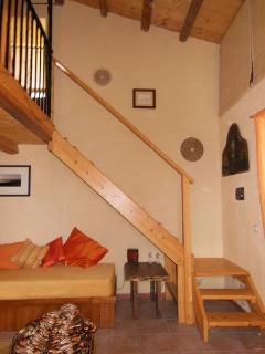 The stairs leading up to the sopalco (loft) bedroom