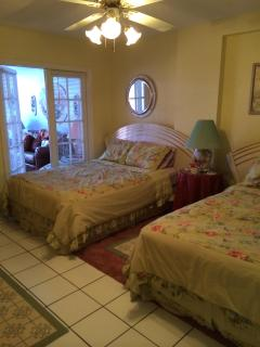 Large bedroom with two full size beds