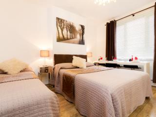 Bedroom 1, sleeps 4 1 double, 2 singles