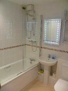 Brand new bathroom, complete with two showers and electric demisting mirror