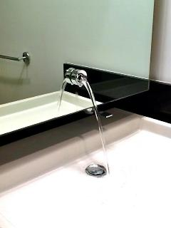 ANOTHER DESIGNER SINK...WATER STRAIGHT OUT OF THE MIRROR