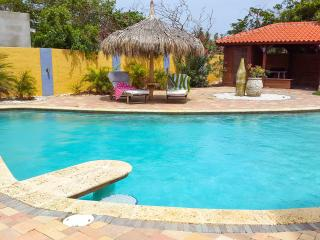 Big pool with poolbar and 2 lounge beds under the palapa