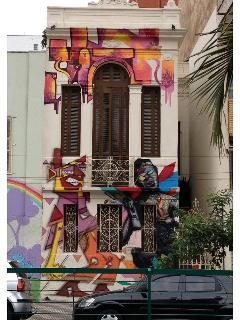 the house facade and the mural by thug alone , biofa and mogle, amazing artists from sp
