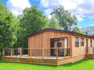LIME LODGE, detached riverside log cabin, romantic, open plan, WiFi, near Clun,