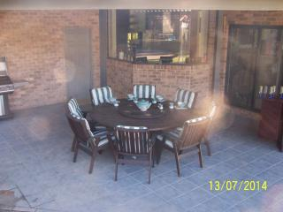 outdoor dining/breakfast area overlooking pool area