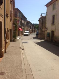 The main street in Arques, with boulangerie and bar/restaurant