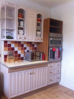La cuisine, modern French kitchen with double range oven, hob, butler's sink and dishwasher.