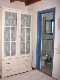 Bedroom - 2. Large closet and a glimpse of the toilette / shower room.