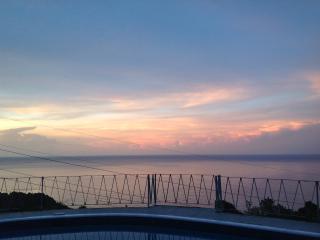 Sunset view from veranda, livingroom and pool deck