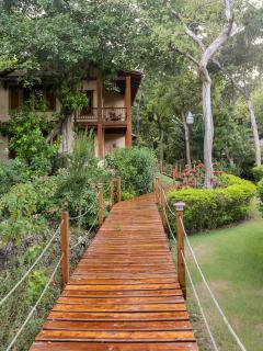 Elevated walkway to Garden suites from main house