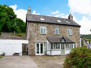 GORPHWYSFA, stone-built, detached property, woodburner, en-suite, garden, in Lla