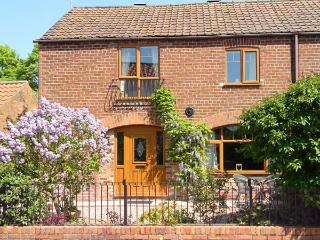1 WOODS GARTH, brick built barn conversion, character features, quiet village, Fimber