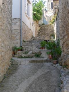 Idyllic, narrow alleys and steps decorated with flower pots lead the way to the house