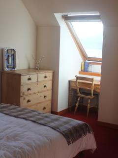 Double bedroom with dual aspect windows offering stunning views of the Loch and Alligin