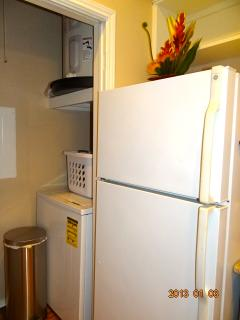 The washer and dryer are inside the condo.