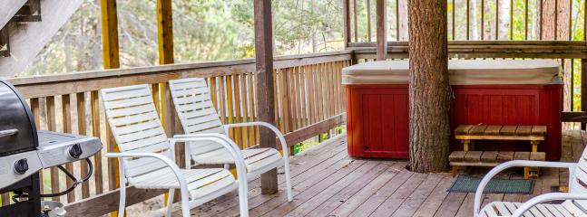 Wide view of the deck overlooking the meadow. Sit in the hot tub and look at the Heavenly mountian