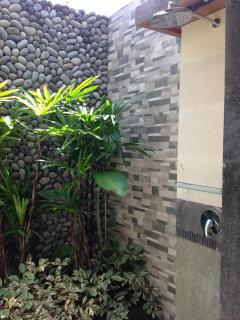 Shower in a soothing, private garden area