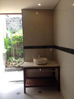 Common bath open to garden shower.