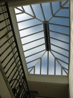 Airy Stairwell with Glass Roof