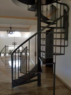 Spiral staircase takes you from the 2nd floor to the 3rd floor rooms