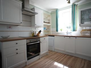 Spacious kitchen with dining area, dishwasher, washing machine and tumble dryer
