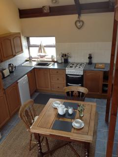 The open plan kitchen and dining area. Perfect and spacious.