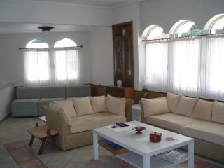 Sitting room with 3 sofas