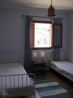 Second bedroom with two single beds.