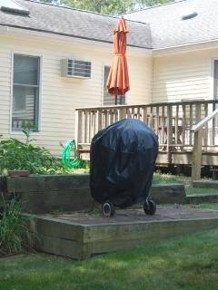 Spacious back yard deck with anti gravity chairs, umbrella, and deck chairs, grilling patio,etc.
