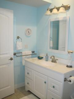 This lovely bathroom is spacious and inviting; one of five bathrooms in the house