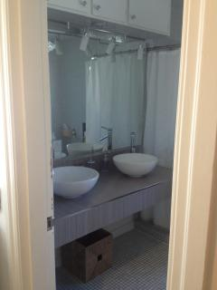 partial view of Bathroom upstairs, this one has Shower and Bathtub