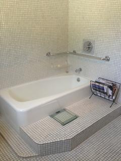 partial view of Bathroom upstairs, this is the Bathtub