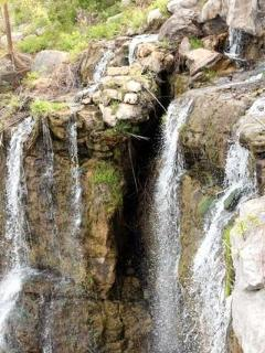 One of the two waterfalls on the property
