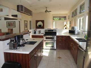 Kitchen overlooking eating area and side entry