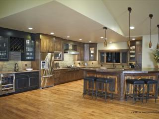 fully-equipped gourmet kitchen and copper bar in Great Room