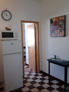 View from Laundry through the kitchen, looking into the Living/Dining