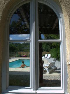 A view of the pool through the arched window