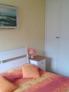bedroom with double bed and televisione