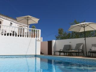 8m x 3.5m pool with lots of rattan sunbeds, cushions and parasols - the annexe is in the background