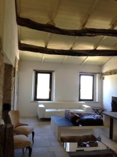 First floor living room and studio, overlooking the ground floor common area with marble pool