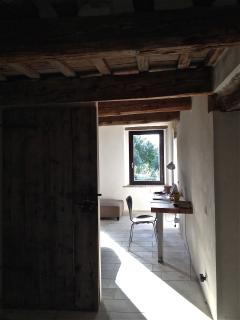 View from the bathroom... italian stone floors throughout the house, and solid oak fixtures.