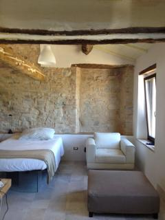 The original stone walls were kept but integrated with fresh,pieces of modern designer furniture
