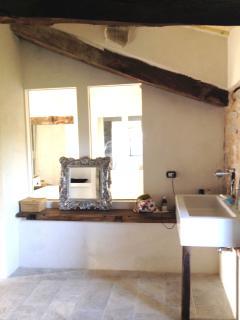 Bathroom: a fortunate melange of original XVIII century beams and modern italian design sanitaryware